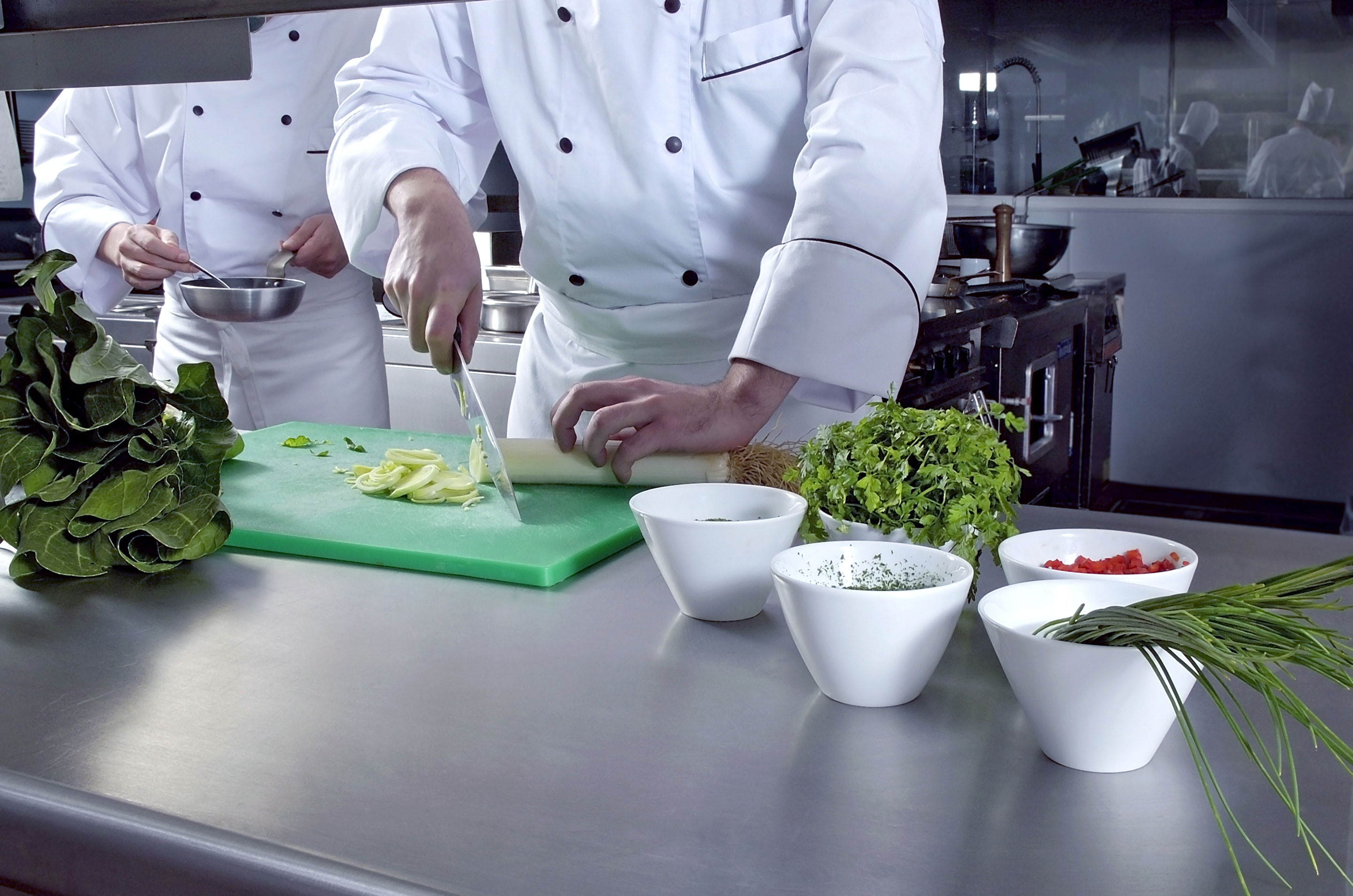 Chefs preparing food in a professional kitchen