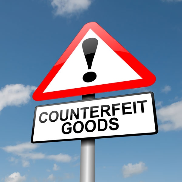 Warning sign with exclamation point and counterfeit goods