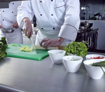Chef preparing food in a professional kitchen