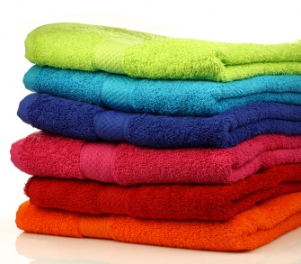Multi-coloured pile of towels